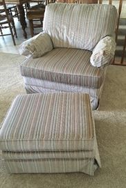 Chair with matching ottoman .