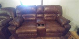 Bomber style dual power reclining  loveseat and sofa/couch with cup holders and storage compartments from Nebraska Furniture Mart
