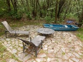 Coleman Rowboat 2 seater, Pair of Chaise Loungers and a Matching Firepit.  The boat has wood oars and anchor. 11 ft by 44 wide.