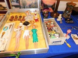 Pre 1965 Barbie's & Ken dolls . Many articles of clothing and accessories .