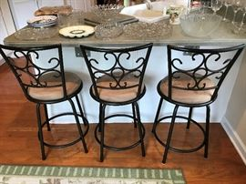Three bar stools.