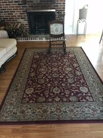 Oriental rug and antique sewing rocker