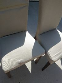 4 padded tan chairs