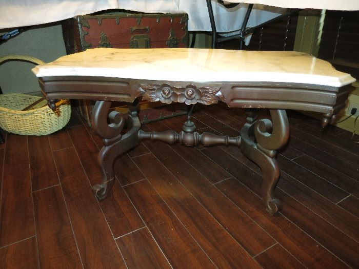 Another very nice piece of furniture. A marble top table!
