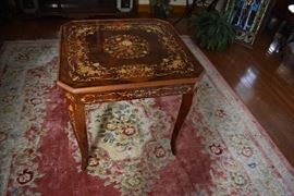 Italian Made Game Table with unique inlaid design throughout.  Top lifts off to expose chest board, checkers board and other game boards