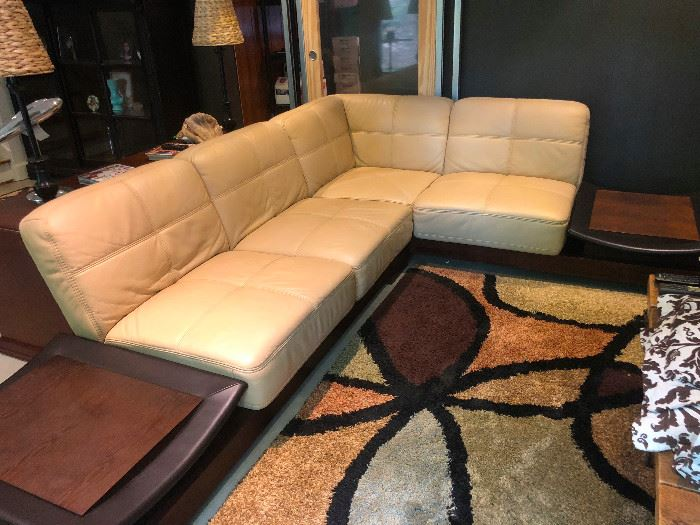 Mid Century Modern Leather sectional with attachable end tables. This is really a unique and beautiful sofa!