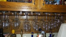 Bar items.  Glasses in all shapes and sizes