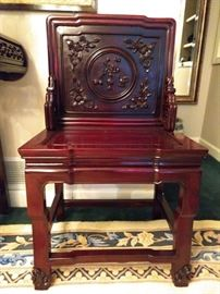 Close-up of the hand carved Chinese mahogany chairs.