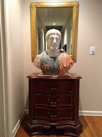 One of several mirrors in the house, reflecting a wonderfully carved marble Marcus Aurelius, atop a banded mahogany 3-drawer chest.