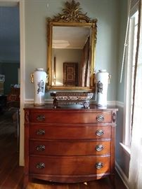 Nice 1940's Drexel mahogany bachelor's chest, with pair of hand painted Chinese porcelain vases, porcelain compote, with bronze mounts and hand carved Italian gilt wood mirror.