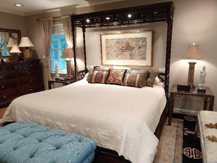 Unique and extra-special king sized mahogany bed, hand painted Asian art on silk above the bed, pair of vintage brass/glass nightstands, pair of lamps with suede shades, pair of blanc de chine figurines, tufted blue & white stool.