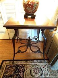 Love this vintage mahogany side table.