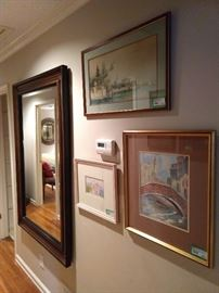 Gallery hallway, with, yes, another large beveled glass wall mirror.