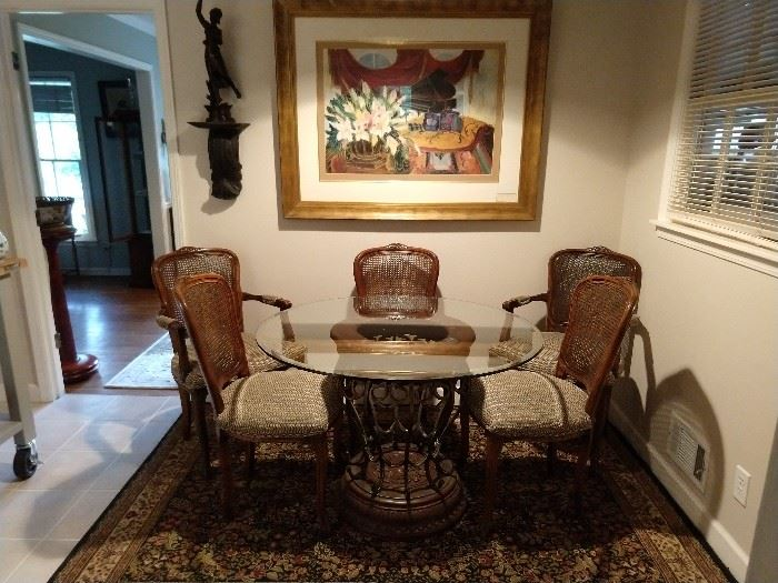 Round, beveled glass topped breakfast able, with set of six French chairs, cane back/upholstered seats - two arms & four sides. Art is by Raschella Collection.