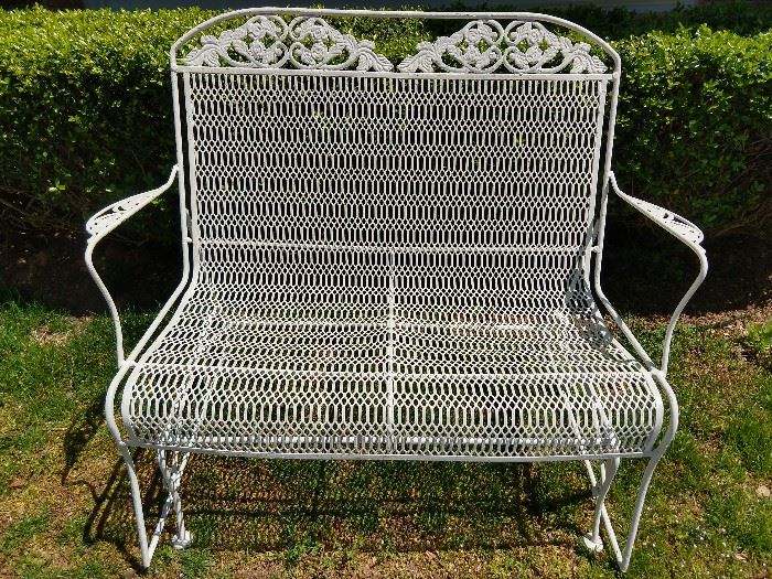 Vintage wrought iron glider, freshly painted for your spring pleasure.