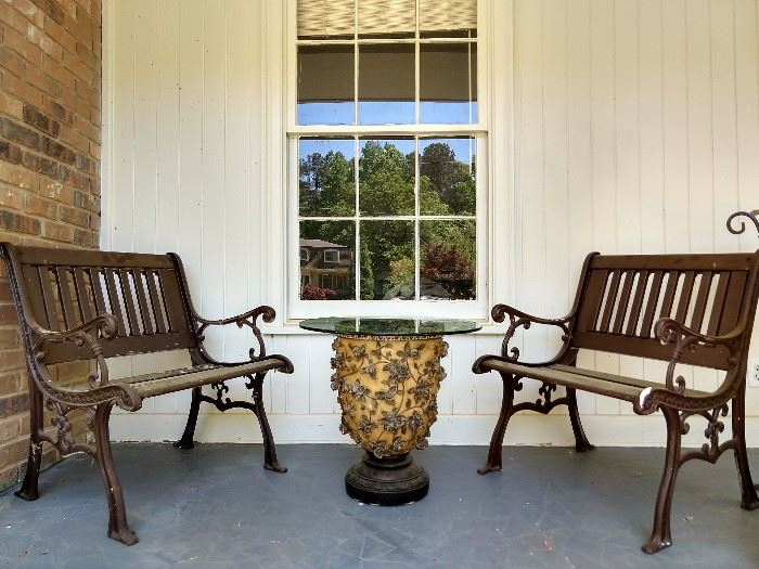 Pair of cast iron love seats,  resin urn with glass top.