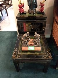 Lovely vintage bi-level end table, with black lacquer finish, gold detail, metal grid and tooled green leather top.