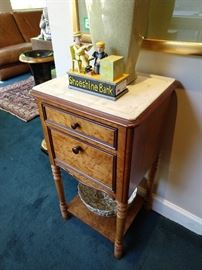 French burled wood end table with milk glass lined interior and white marble top.