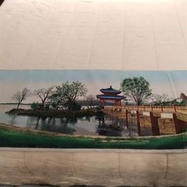 """Nicely executed woven tapestry of an Asian temple on a lake, measures 5' 8"""" x 17""""."""
