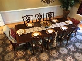 $2,500.  Dining table, 8 chairs, and hutch (not shown).