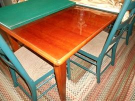 "Thomasville dining room table  100"" (includes two 18"" leaves) 40"" wide"