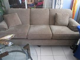 "Ethan Allen Sofa, tan color, 82"" wide X 36"" deep.  Looks like it was never sat on."