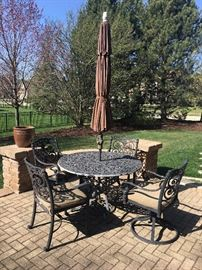 Start summer off right with this great patio dining set.  Complete with Sunbrella cushions and umbrella.  This set is heavy duty wrought iron.