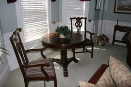 Vintage Round Mahogany table with two wing chairs