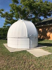 Telescope & accessories inside.