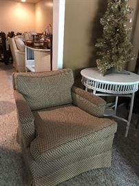 Club chair ....  Antique wicker table