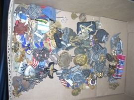 Loads of Military pins and insignia.