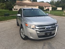 2013 Ford Edge.  Asking $18,500.