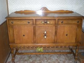 Buffet with (3) drawers and (3) doors for storage.  Also, there is a matching table with two leaves and (6) chairs. (see photo).   $450.00 for buffet, table (2) leaves,  (6) chairs and professionally made  table pads.