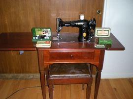Singer sewing machine 201-2  w/ original cabinet, stool and accessories. .  $450.00