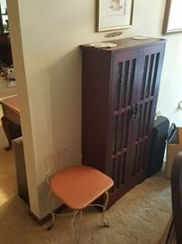 Mission-style cabinet and Vintage chair. Cabinet is full of CDs.