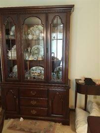Gorgeous Hutch filled with antique dishes and trinkets.