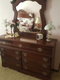 Master bedroom dresser.  Set includes this dresser with mirror, headboard, 2 nightstands, and 2 highboy dressers.  Glass lamps.
