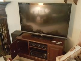 Vizio TV, components, and Stand. Fireplace tools set.