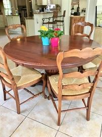 Nichols & Stone pedestal table with one leaf, 6 rush seat chairs made in Italy