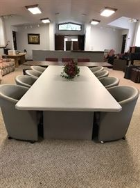 Know anyone that just opened an office or needs a  conference table with 8 swivel chairs ?