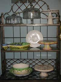 Baker's rack, loaded with cake stands and cake plates