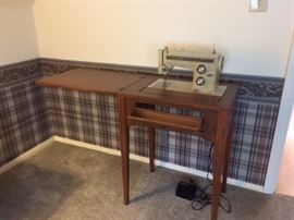 Kenmore sewing machine in stand...foot pedal and accessories.