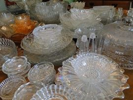 Lots of beautiful dishes and serving pieces