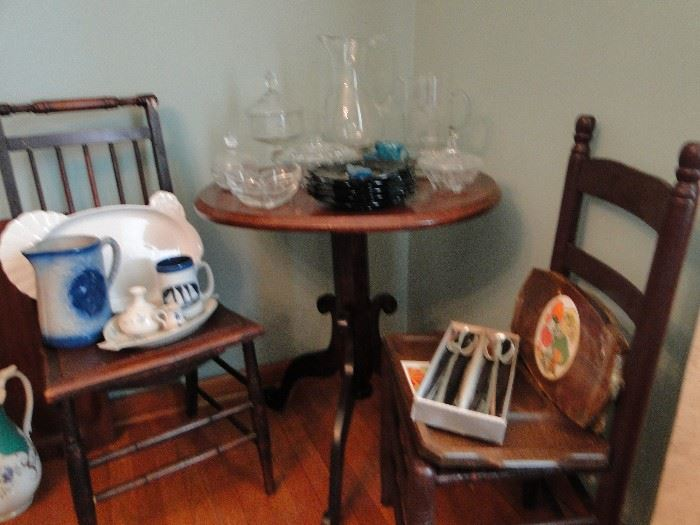 Cane Bottom Chairs and  an occasional table, a Pfaltzgraff Turkey Platter, and beautiful pottery