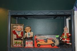 A sample of vintage collectibles which includes a new Prop Rod toy car in it's original box!