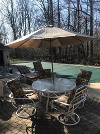 8 piece Tropitone aluminum patio set, includes table, umbrella and base, 4 swivel rocking chairs, 2 adjustable lounge chairs and 6 cushions!