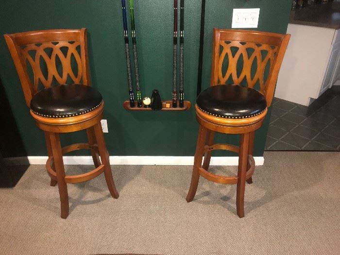 2 leather bar/billiard stools.