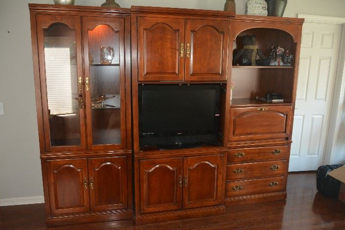 Beautiful cherry Thomasville wall unit. 3 separate units. Also includes doors for tv area.