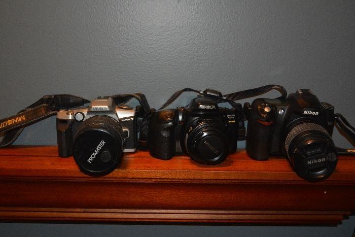 Nikon D50, Minolta Maxxum 450si, Minolta Maxxum 5, with lenses.