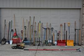 A wide array of outdoor tools, including an electric chain saw and tree limb clipper. There is a LOT more items in the garage too.